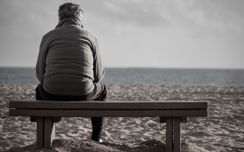 Elderly Man Isolated on A Bench